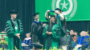 Woman on stage at UNT graduation ceremony